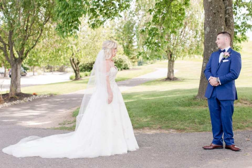 The bride and groom see each other for the first time outdoors at the Skyview Golf Club
