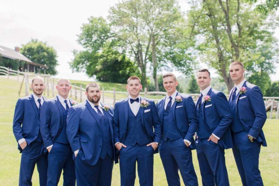 Groomsmen and groom formal photo. Navy blue tuxedos by the Clothing Center.