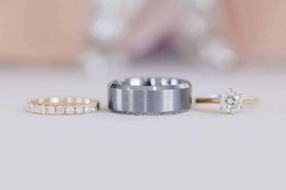the rings: diamond and gold wedding band, platinum brushed wedding band, round diamond solitaire engagement ring