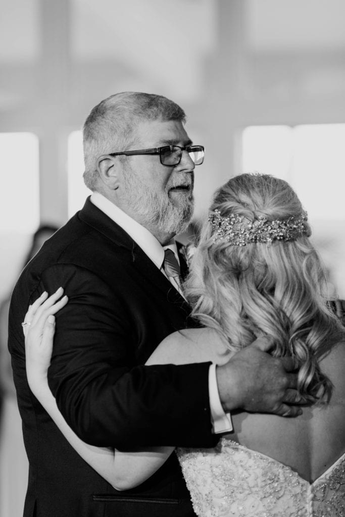 black and white photo of the father of the bride dancing with his daughter