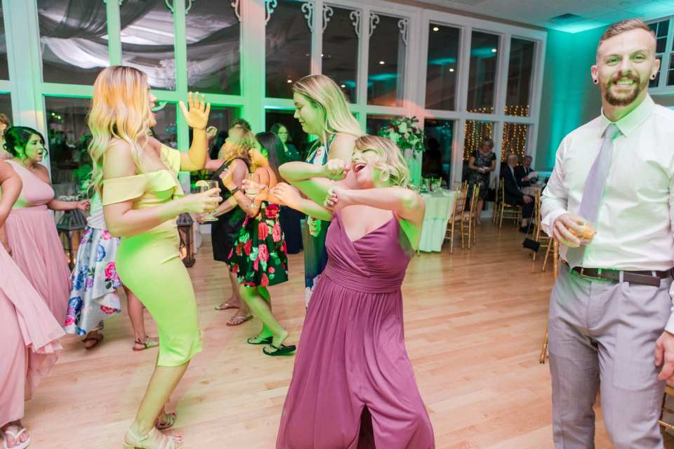 guests dance during the reception at the Skyview Golf Club