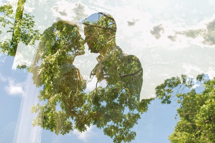 Double exposure of the bride and groom nose to nose and the grounds of the Mountain Lakes House