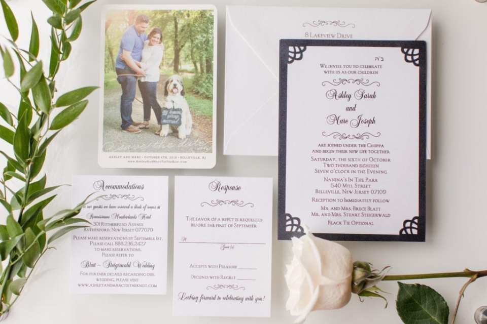 White and black invitation suite by Sandra Creative Designs