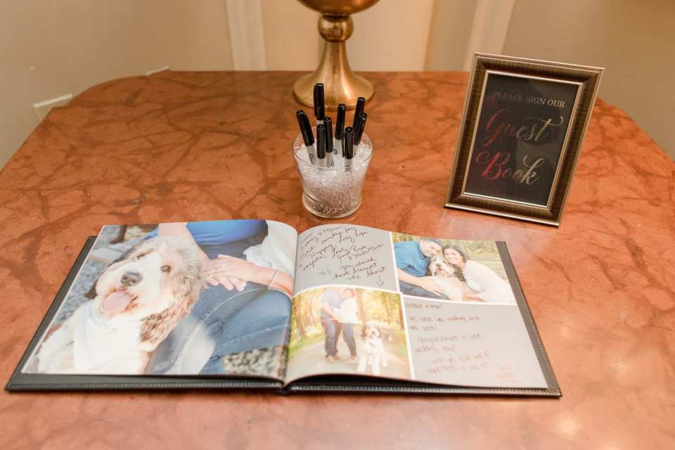 The photo guest book on display with signage