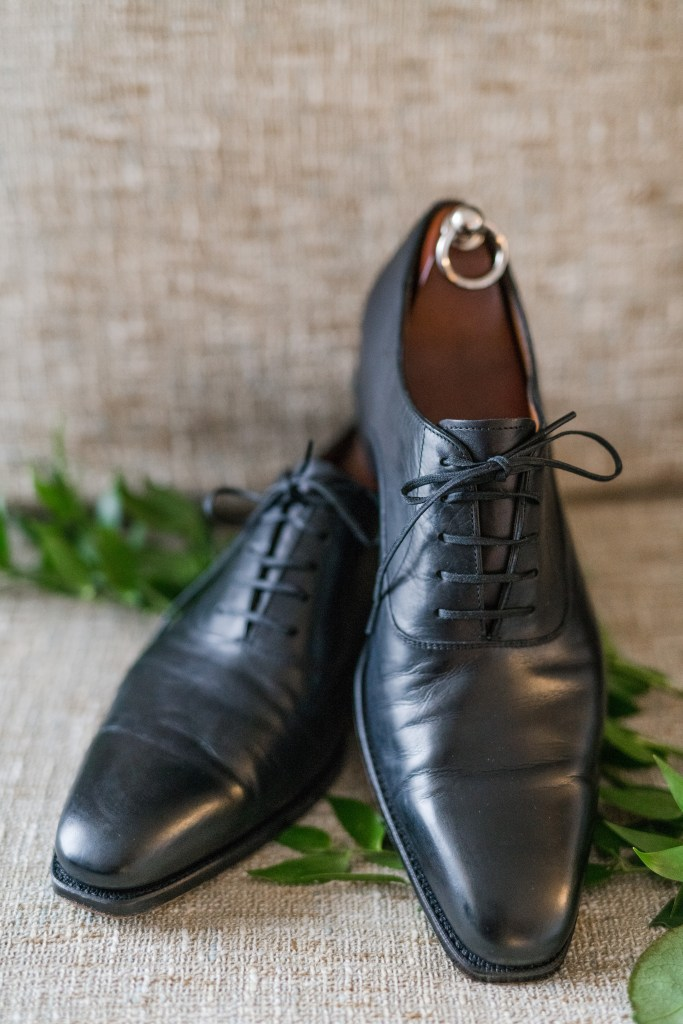 The grooms black shoes on display