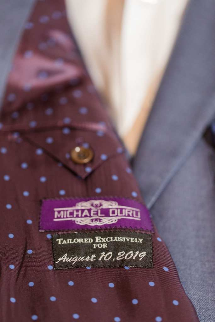 Inside of custom suit by Generation Tux with label sewn in specifically for it with the date