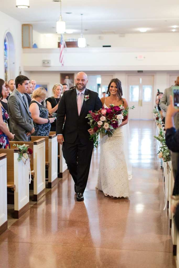 the bride is walked down the aisle by one of her brothers