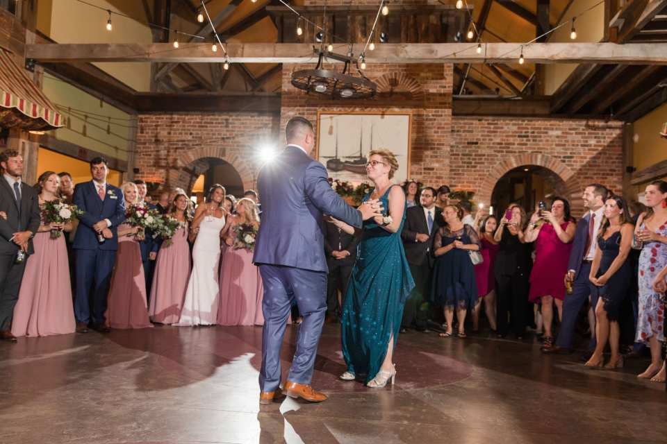 The groom shares a dance with his mother at the Laurita Winery