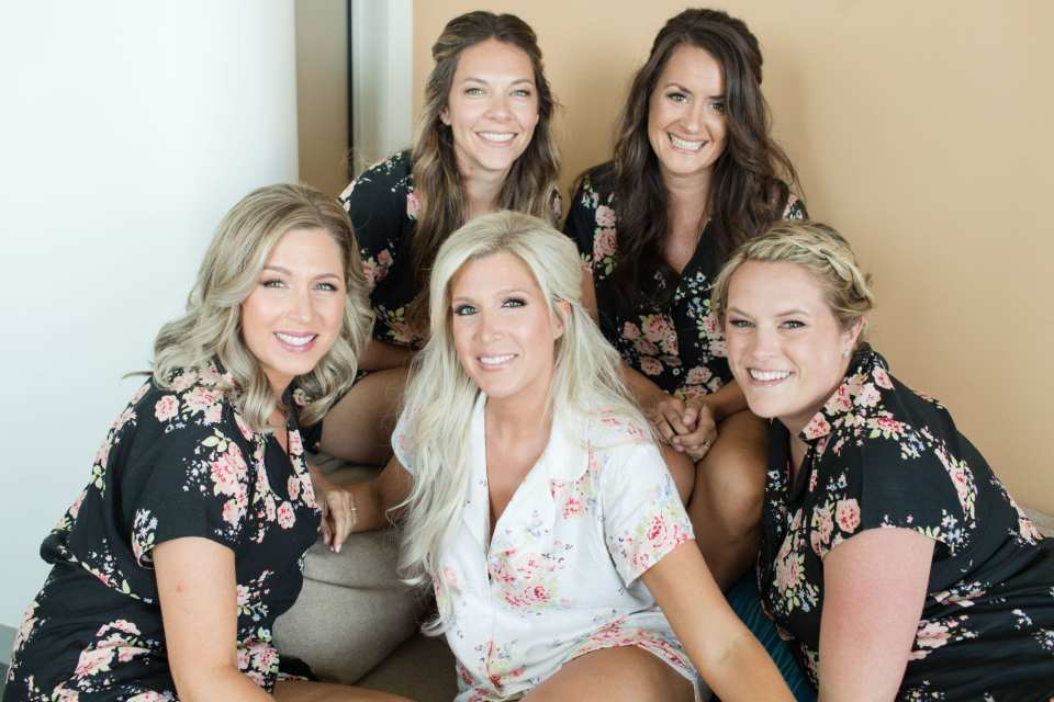 The bride and her bridal party in coordinating short sleeve shirt and short pajamas
