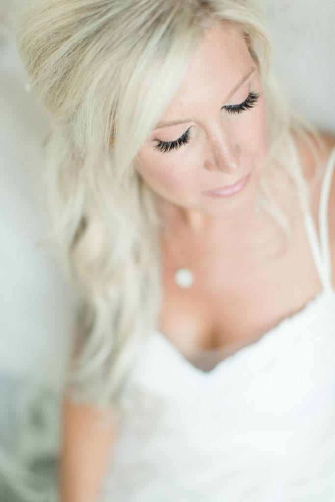 Portrait of the bride from above, her makeup and eyelashes highlighted