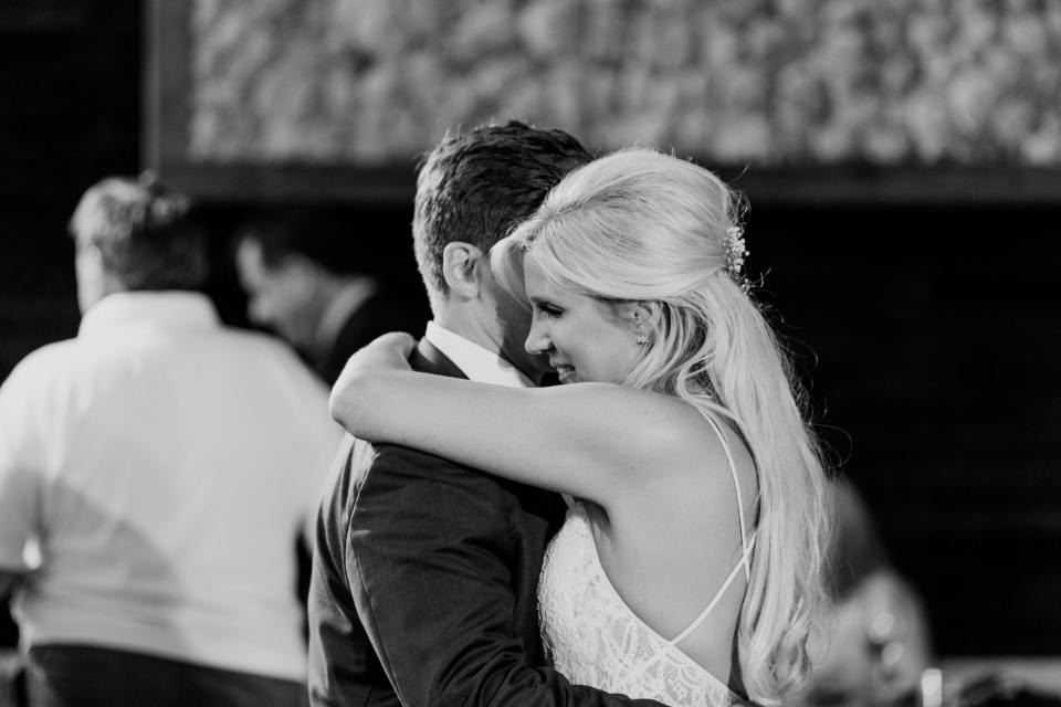 Black and white photo of the brides face during the first dance