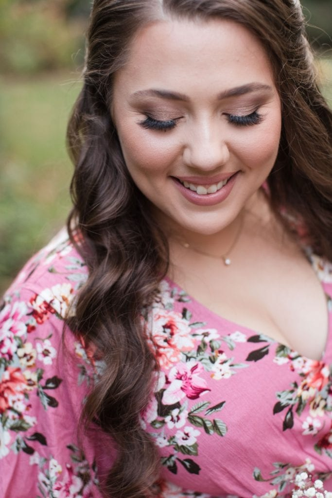 The bride to be shows off her makeup by Annas Bridal hair and makeup during her engagement session