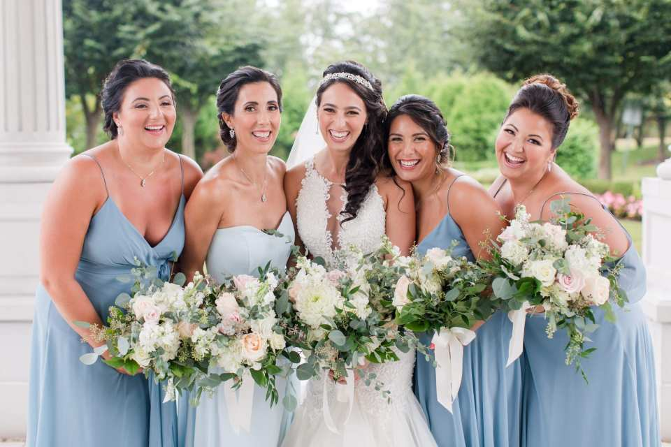 Fun photo of bridal party dressed in Jenny Yoo, all bouquets in focus