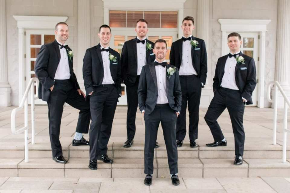 Formal photo of the groom with his groomsmen in their Enzo tuxedos