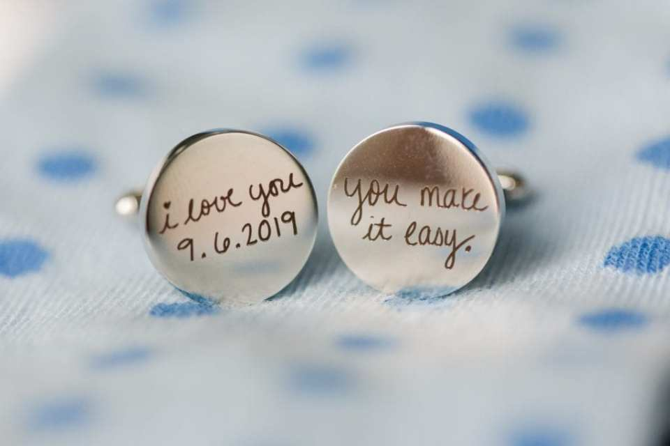 Custom engraved cuff links with the date of the wedding and a phrase on them