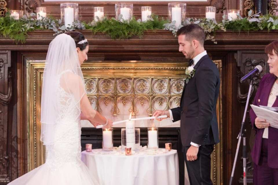 Bride and groom during the candle lighting portion of the wedding ceremony