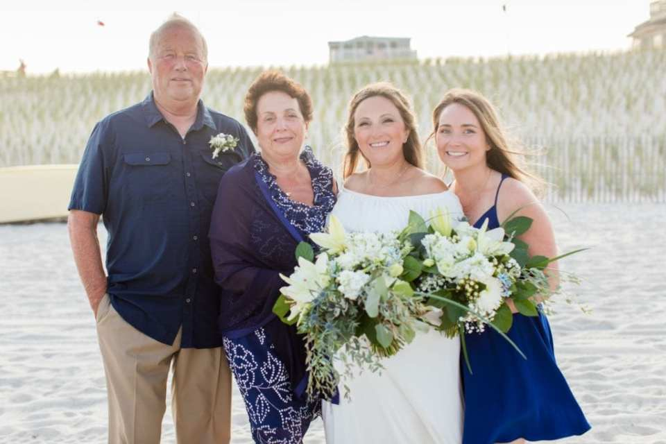 The bride and her family on the beach