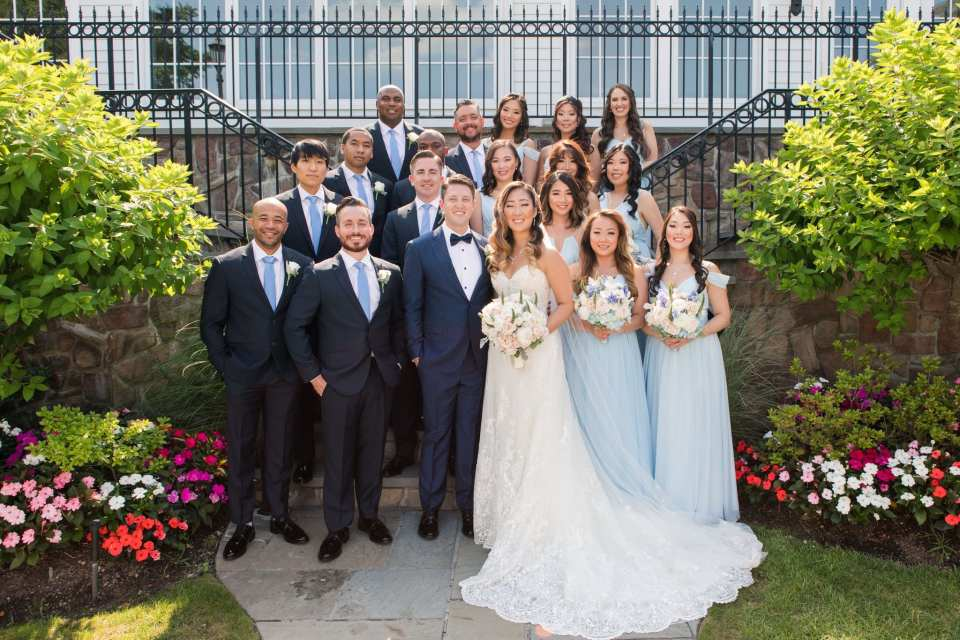 Formal wedding party photo on the steps outside the Park Savoy Estate
