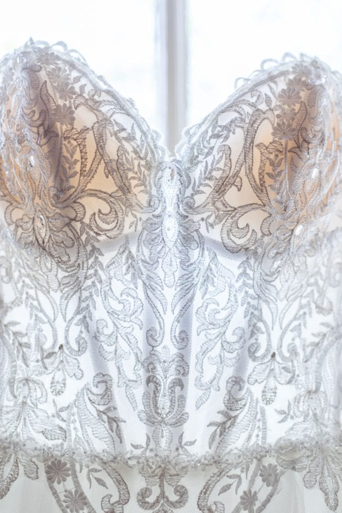 Close up of the lace bodice of the brides Maggie Sottero gown