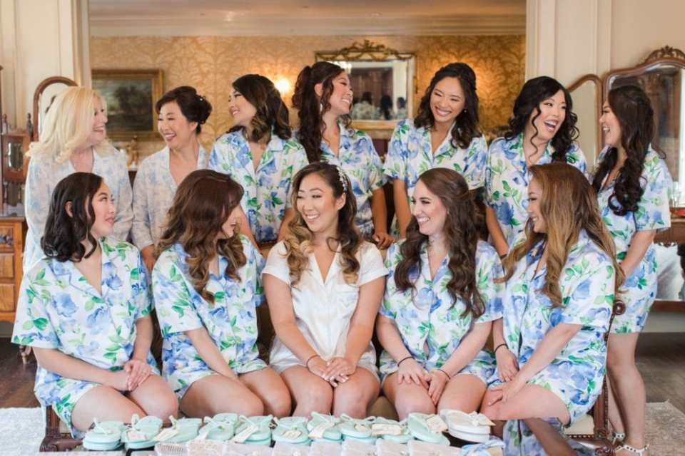 Fun photo of the bride and her bridal party in silk pajamas