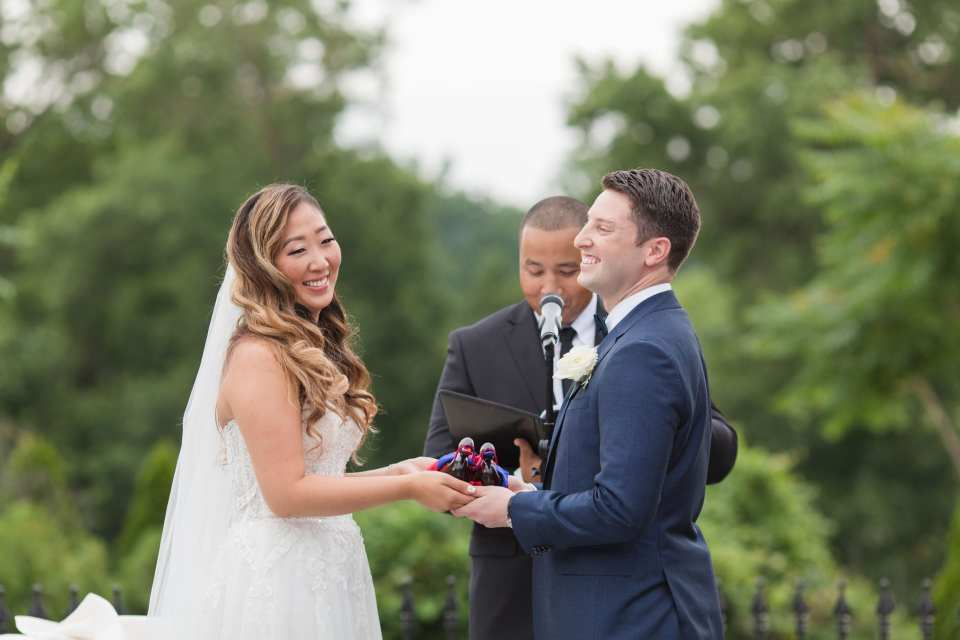The bride and groom laugh during their wedding ceremony