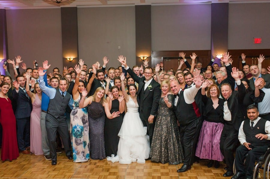 Photo of all attending wedding in a happy pose