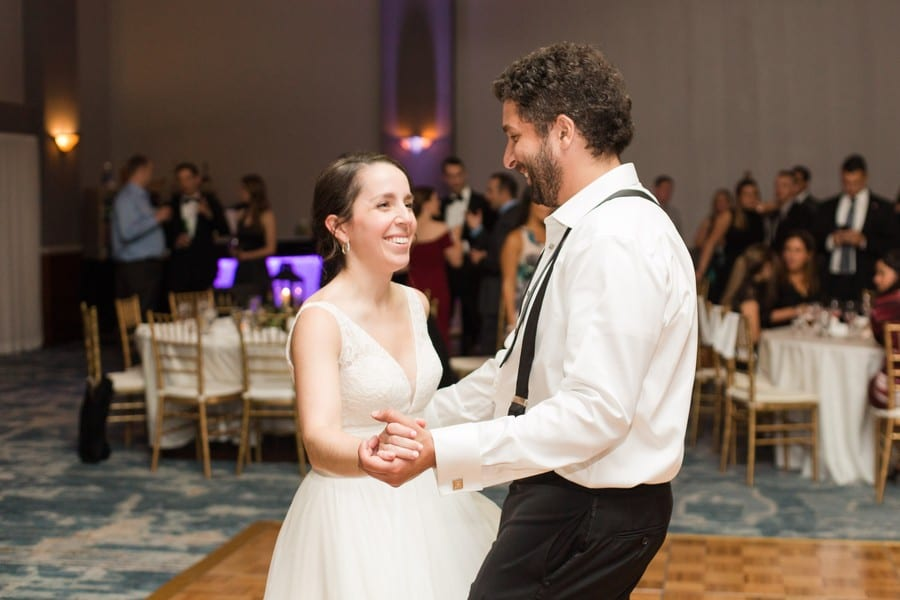 The bride shares a dance with a guest during her wedding reception