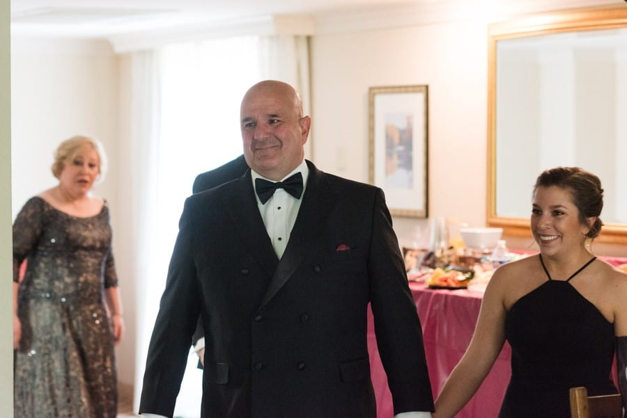 The brides father beams as he sees her for the first time
