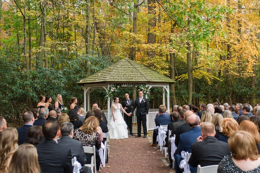 Wide angle photo of the bride and groom during their Princeton Marriott at Forrestal wedding ceremony