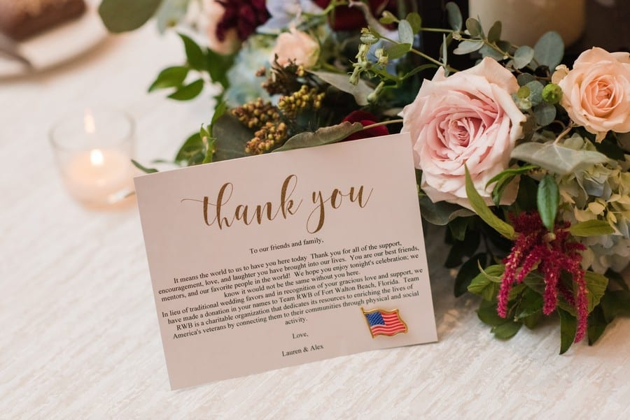In lieu of favor card set against table florals by Petal Pushers