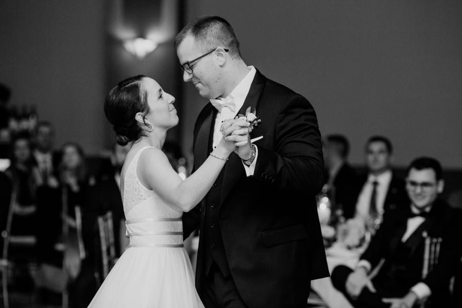 Black and white photo of the bride and groom sharing their first dance as husband and wife