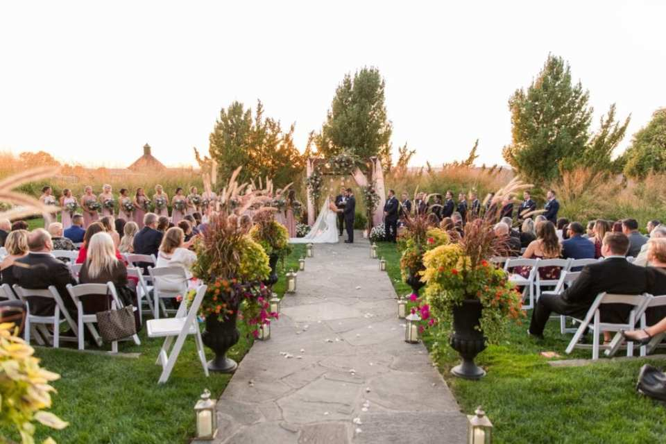 Wide angle photo of an outdoor wedding ceremony at the Grand Cascades Lodge at Crystal Springs Resort