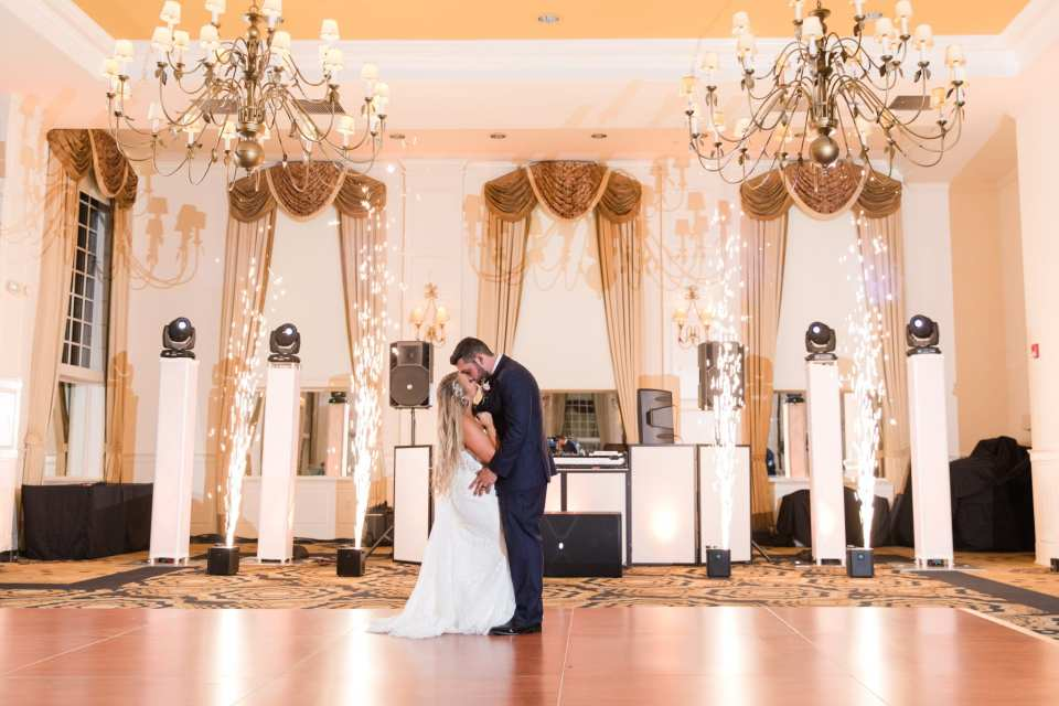 The bride and groom share an intimate moment in the ballroom at the Grand Cascades Lodge at Crystal Springs Resort, with fireworks effects by DJ Tony Gia