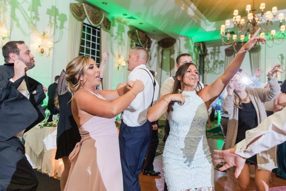 Guests dancing during the wedding reception at Grand Cascades Lodge at Crystal Springs Resort