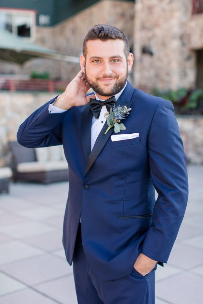 The groom in a navy tuxedo by Chazmatazz