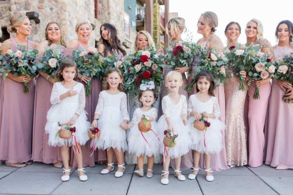 Fun bridal party photo with the flower girls in focus