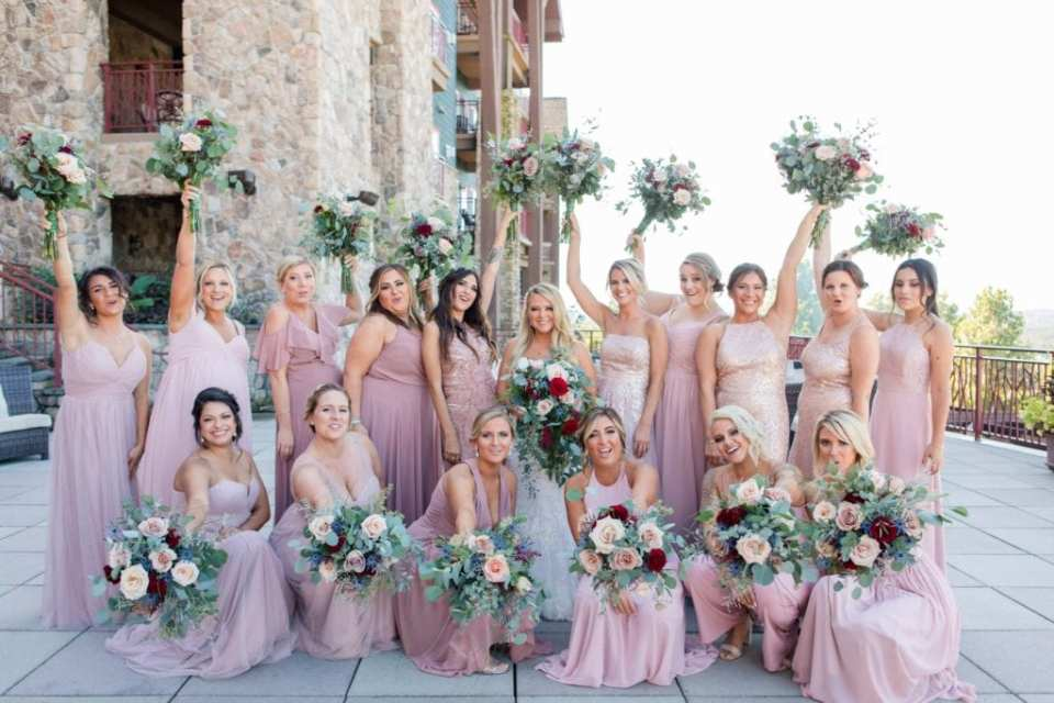 Fun bridal party portrait. Pink gowns from Bella Bridesmaids, florals by Added Touch Florist