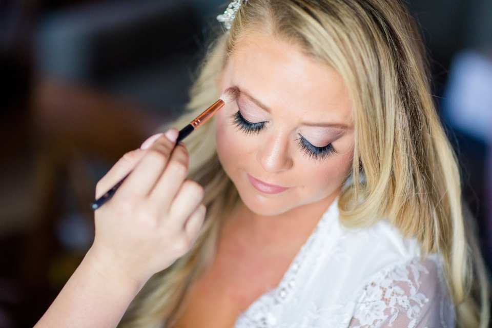 Close up of the brides face, eyes closed, as she is having her makeup applied by Colorbar the Salon