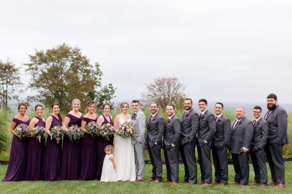 Formal photo of the wedding party in plum and grey in these Blue Mountain Resort Wedding photos