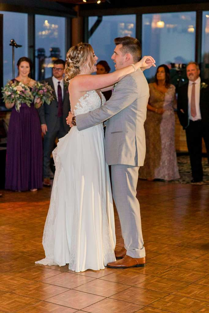 A profile photo of the bride and groom singing during their first dance as husband and wife