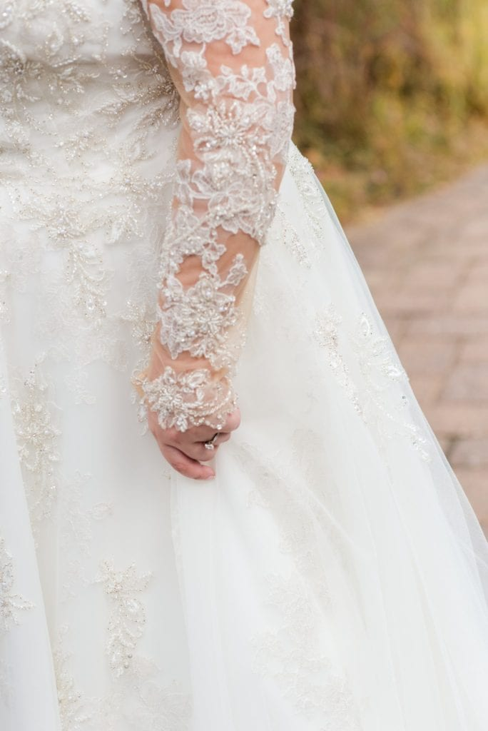 Lace details of the sleeve of the brides Justin Alexander gown