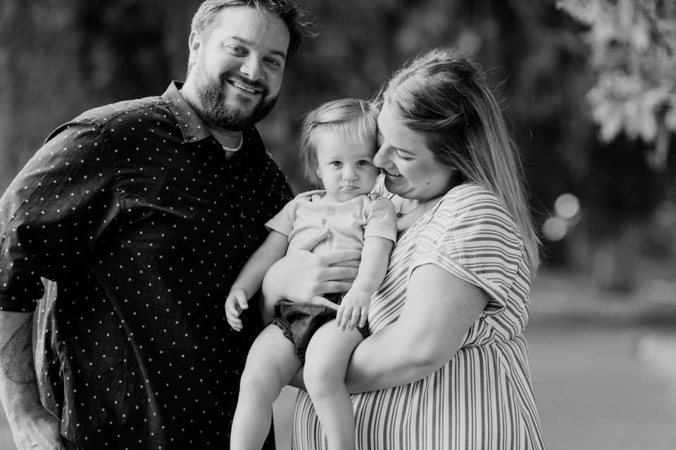Black and white candid family portrait