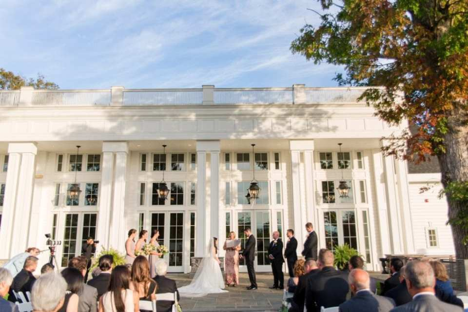 wide angle photo of the wedding ceremony in these Ryland Inn Wedding Photos