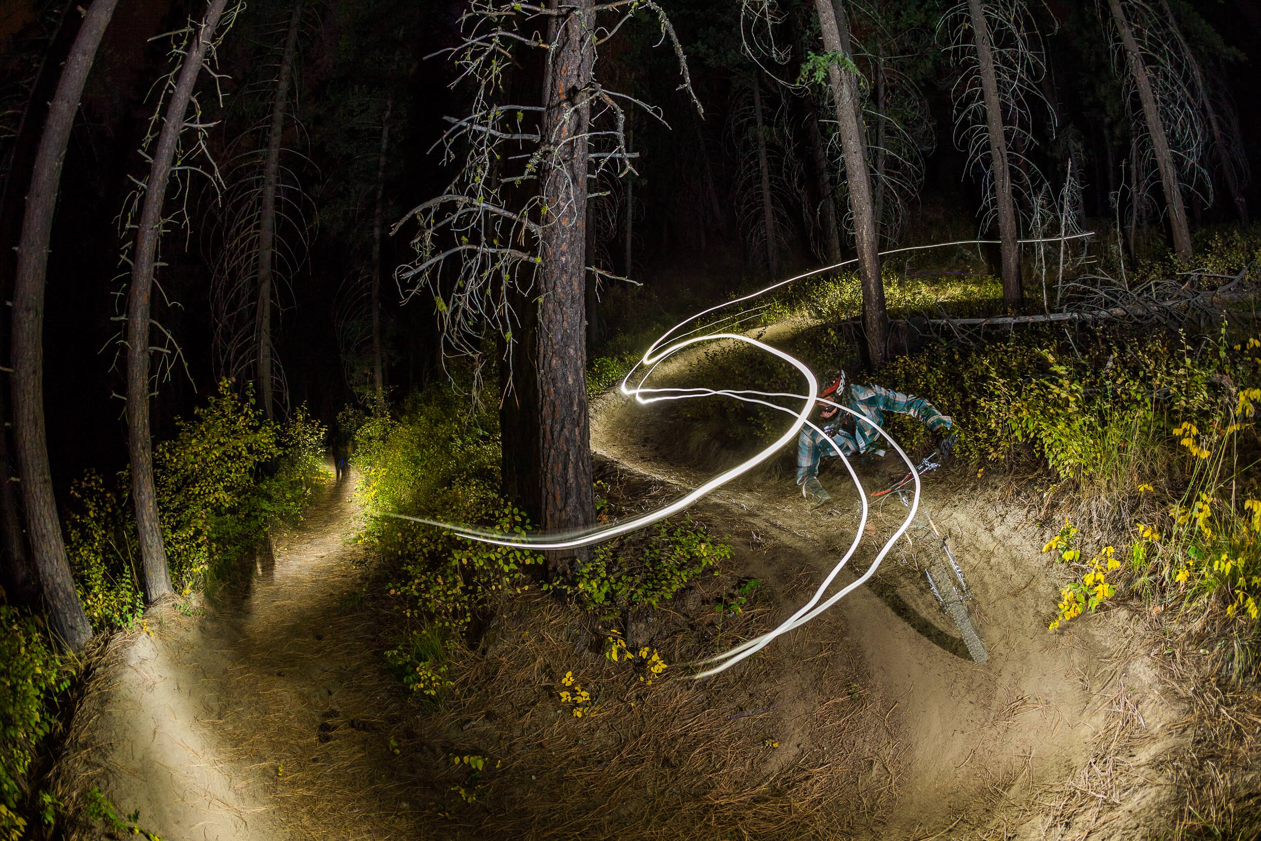 Rex Flake riding single track after dark for the Leavenworth Mountain Association