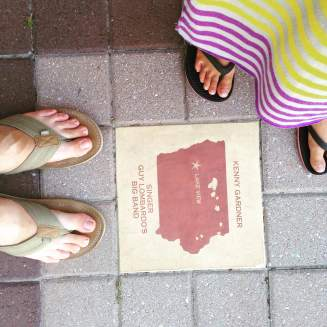 Step on a crack and you could break a famous Iowan's back! Dozens of stones throughout Shenandoah's main business district.