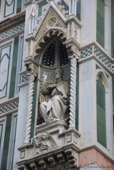 A saint or a pope in a niche on the facade of the Cathedral....