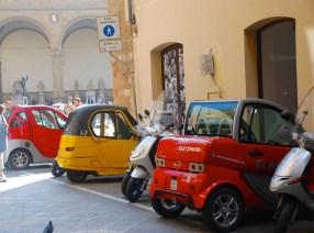 a series of smart cars line up near the Piazza della Signoria