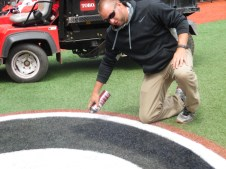 Director of Ground Daniel Moore spray paints the Georgia Logo for a game against South Carolina. This is done before batting practice. (April 15th) Photo Credit: Jaylon Thompson, Multiplatform news