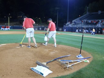 The post game work continues. Two groundskeepers begin fixing the pitchers mound after the game. They will rake and add more clay. (April 15th) Photo Credit: Jaylon Thompson, Multiplatform news
