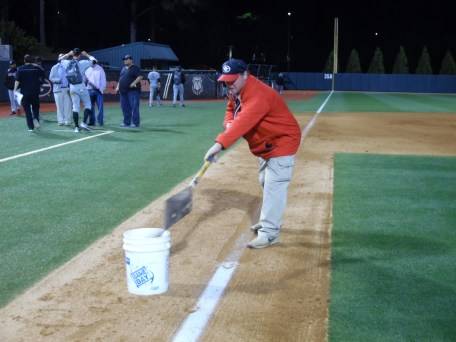 At 10:30, Paul Zakrzewski, a full time groundskeeper, starts post-game clean up. He is stripping paint , so the base line can be watered. (April 15th) Photo Credit: Jaylon Thompson, Multiplatform news